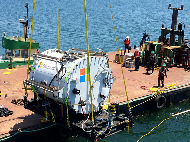 An underwater server pod being hoisted out of the water