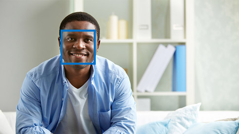 Man using facial recognition