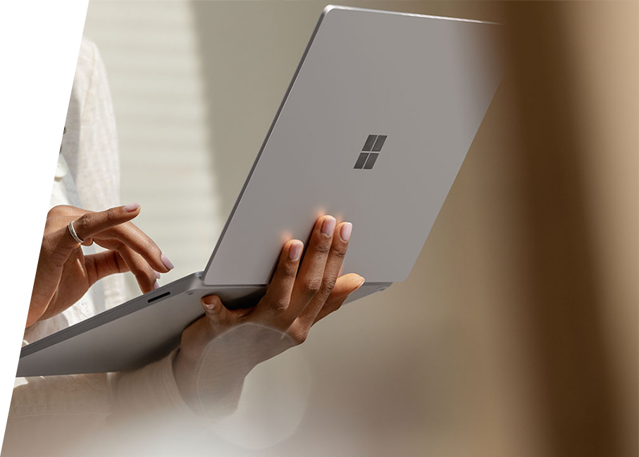 woman holding Surface Laptop 3 in Platinum typing on keyboard