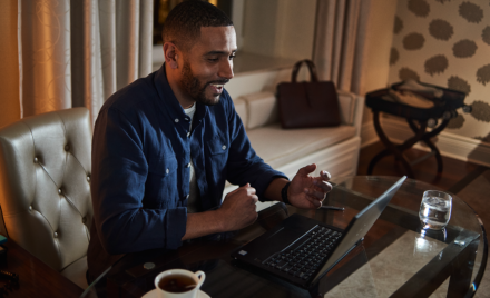 Image for: Image of a remote worker conference-calling on his laptop.