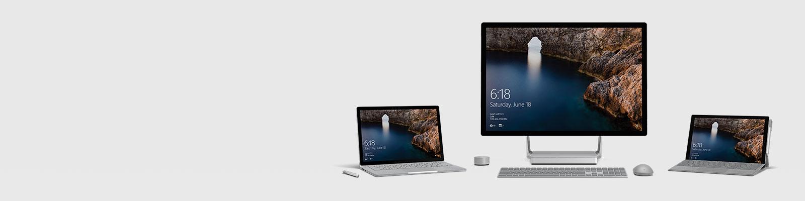 Es werden drei Surface-Geräte gezeigt: SurfaceBook, SurfaceStudio und SurfacePro 4.