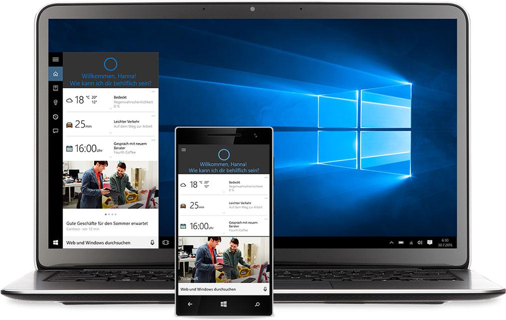 Laptop und Windows-Smartphone mit Cortana auf dem Bildschirm