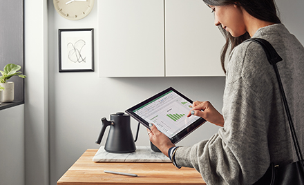 Image of a worker at home using a tablet.