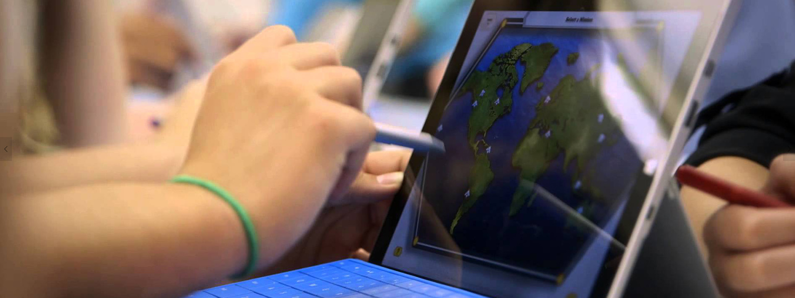 Young kids drawing on their Surface Pro 4 with Surface Pen