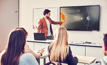 Image of a presenter giving a presentation in PowerPoint.