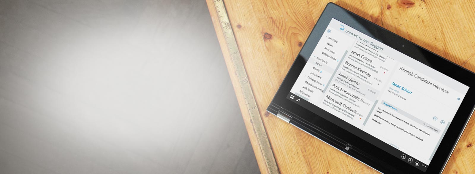 A tablet on a table, showing a close-up of a business email inbox, powered by Exchange.