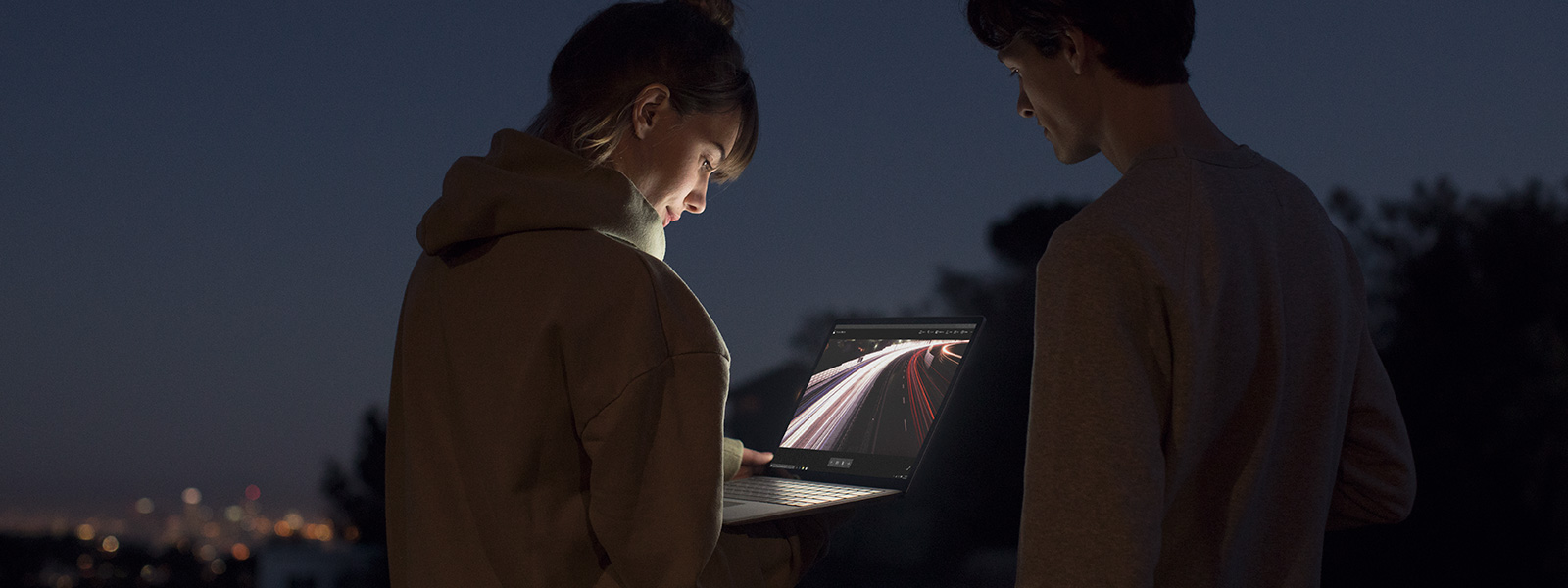 Woman using Surface Pen on a Surface touchscreen.
