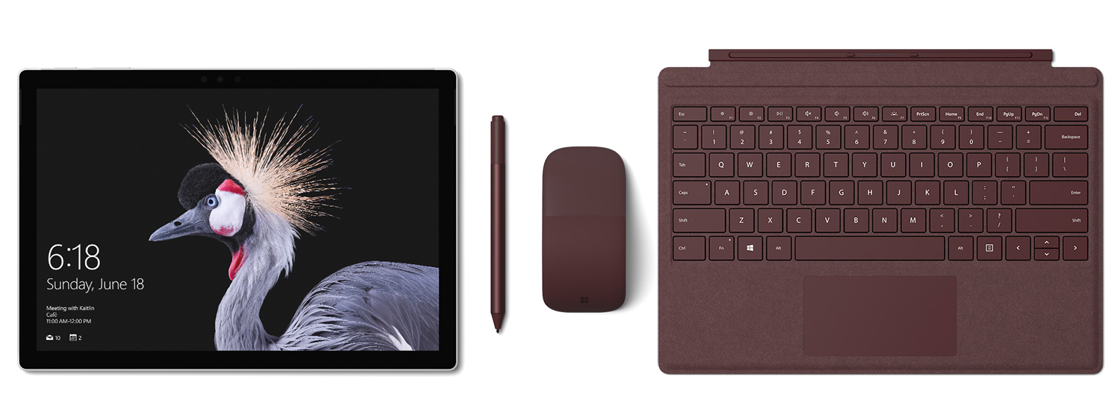 Image of the Surface Pro with Surface Pro Signature Type Cover, Surface Pen and Surface Arc Mouse in Burgundy. Surface Pen accompanies.