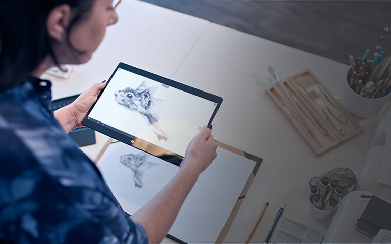A woman using a Windows 10 PC