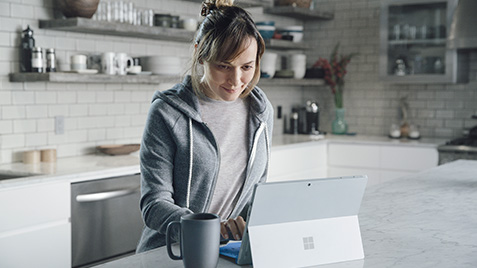 A man using a Windows 10 PC in tent mode