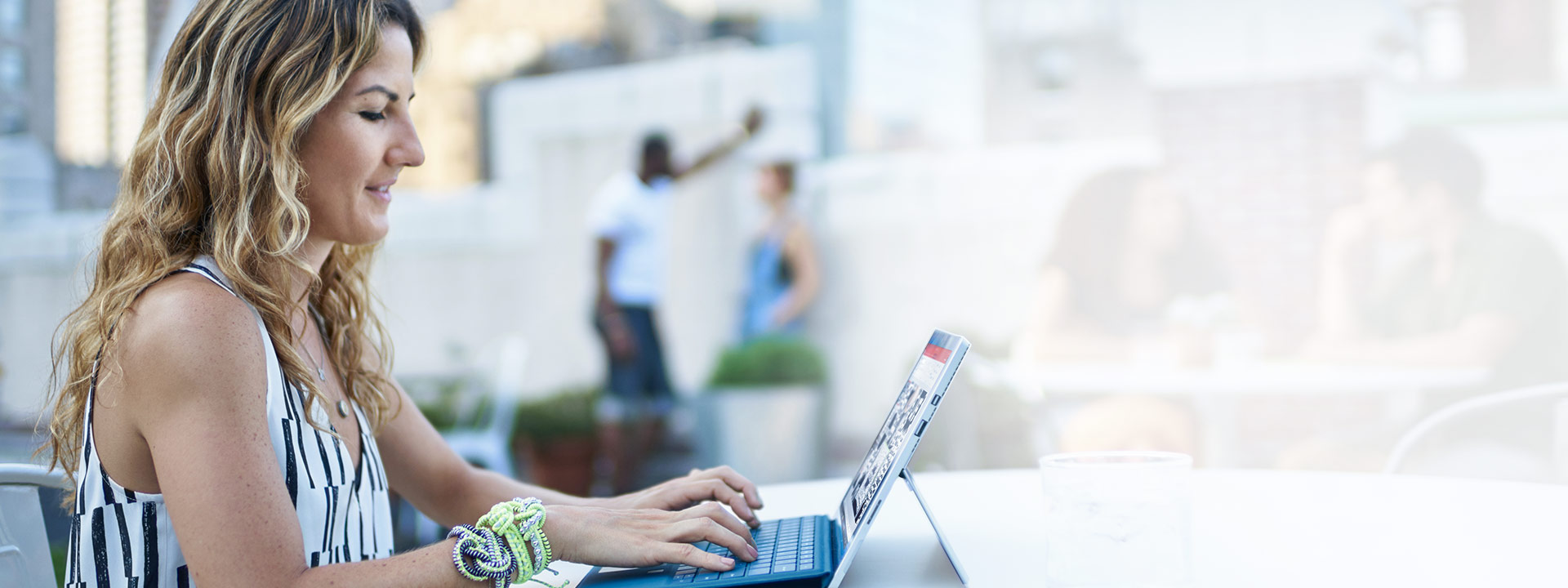 A man using a Surface Book