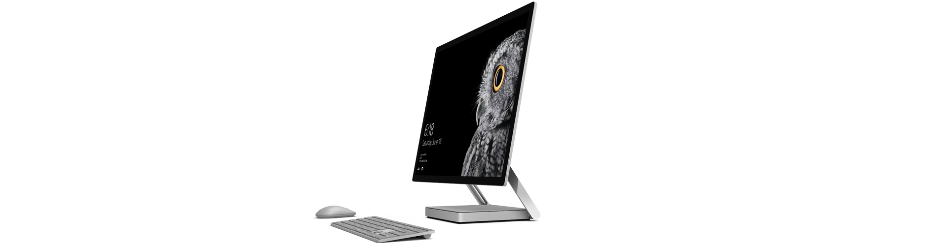 Surface Studio in upright position with Surface mouse and keyboard.