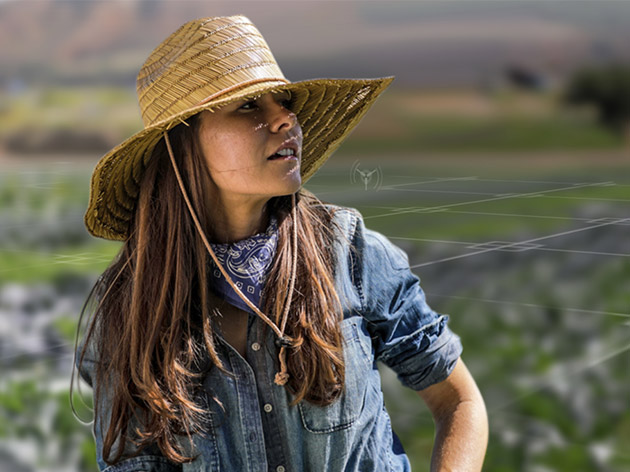 Agricultural worker wearing a hat