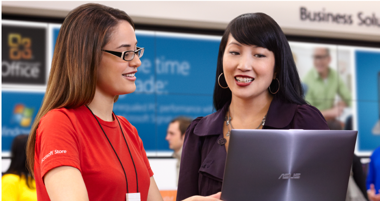 Microsoft store associate helping a business owner