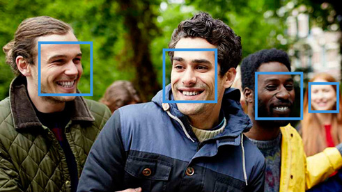 Cognitive services being used to identify four faces in a photograph