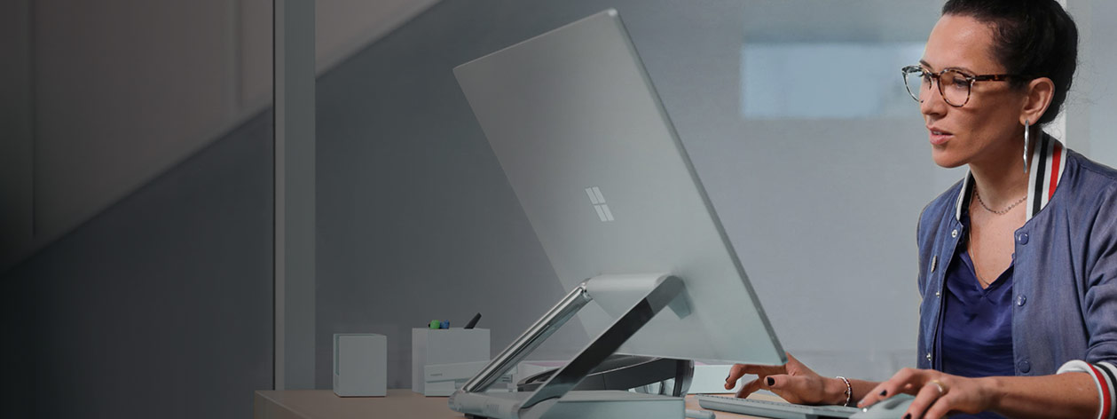 Microsoft employee working at her computer