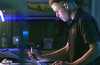 Man uses Surface Studio in his workshop in Studio mode