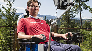 Steve Gleason sits in technology-enhanced wheelchair