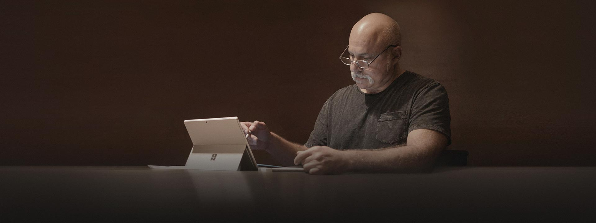 Man with Surface Pro 4, learn more