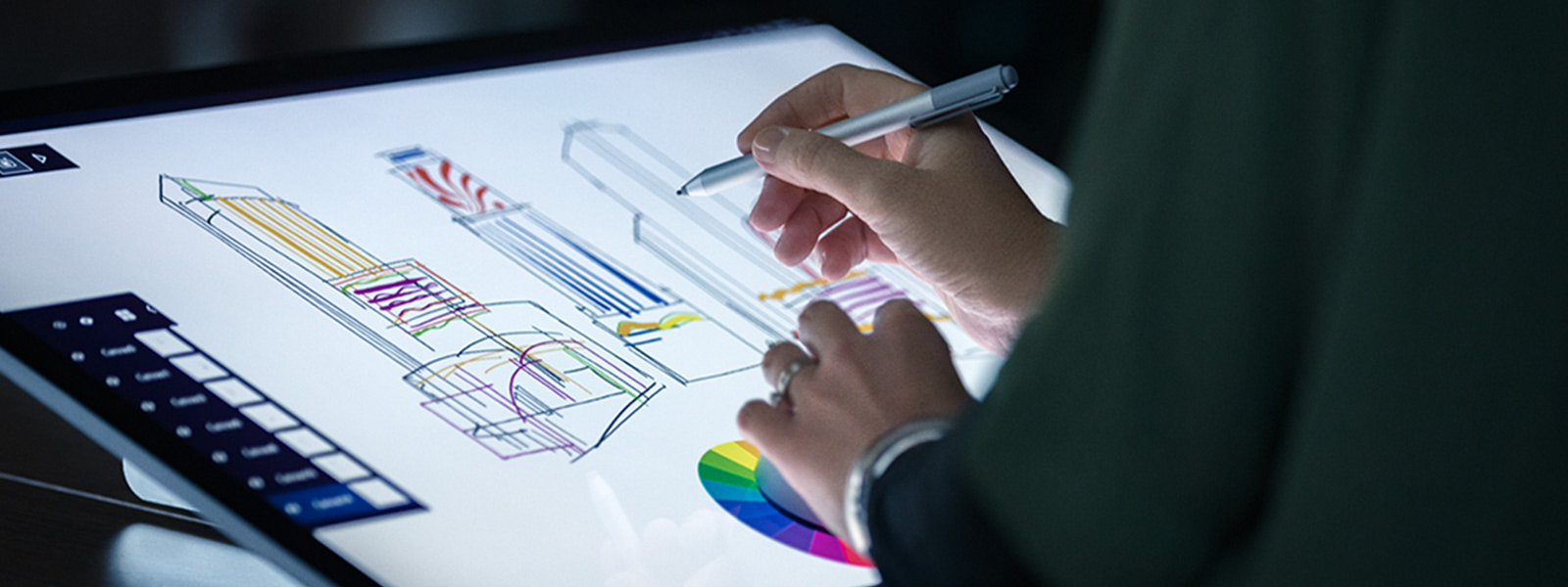 Person using Surface Dial and Pen on Surface Studio screen to create architectural drawings.