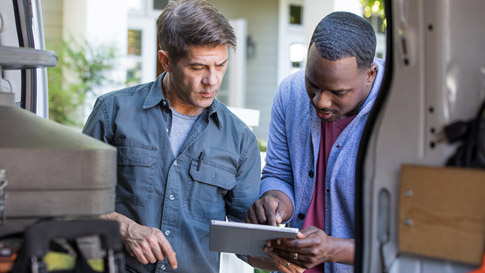 2 Men looking at a tablet device