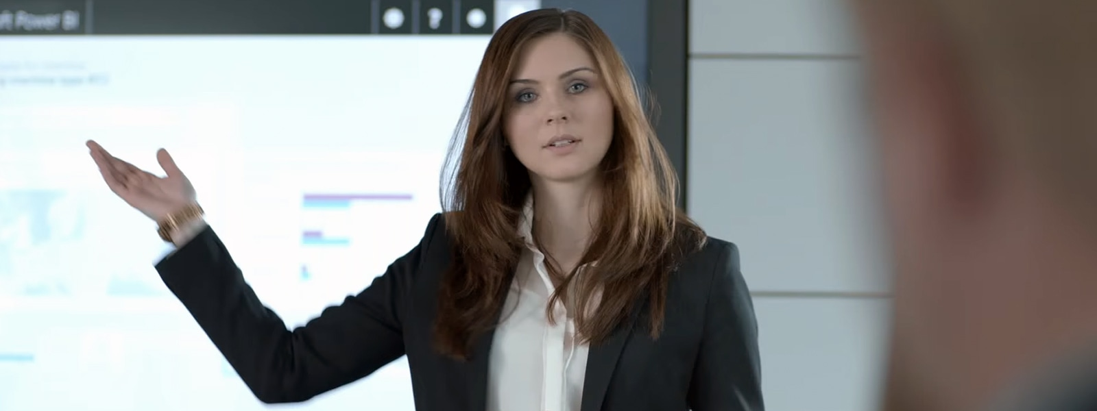 Woman presenting in a business meeting