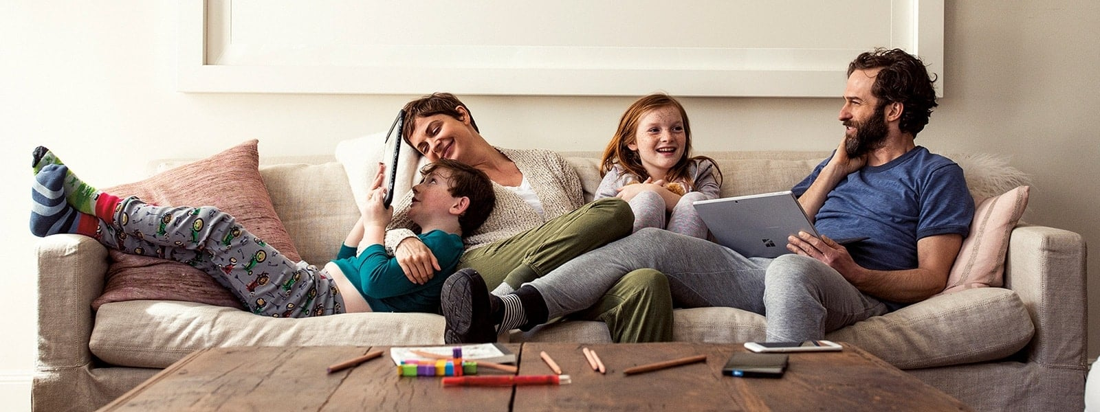 Family laying on couch