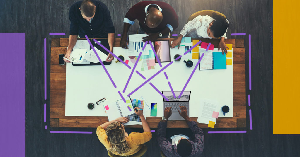 Team of people collaborating across conference table