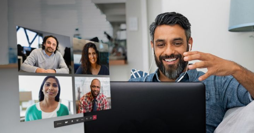 Man smiling at monitor where he is attending Teams meeting
