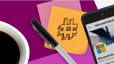 Coffee cup to left of post-it with pound sign drawn on it and mobile device to the right