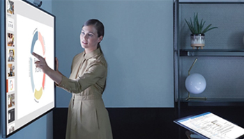 Picture of women in front of smartboard