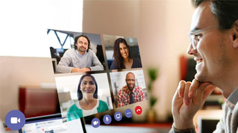 Man looking at a screen with a Microsoft Teams meeting on it