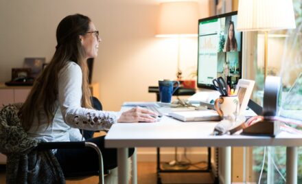 Image for: Woman using Skype for work meeting.