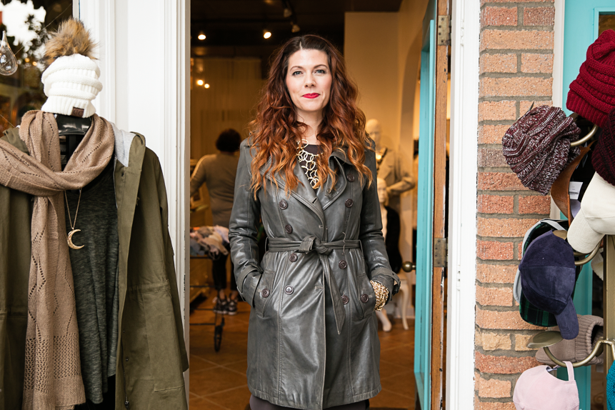 Mellicia Marx, entrepreneur and operator of Poplin Style Direction, poses in front of a boutique.