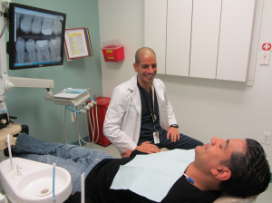 Dr. Taddeo with a patient.