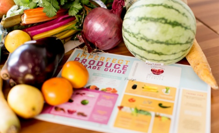 Image for: Imperfect Produce brochure surrounded with fruits and vegetables.