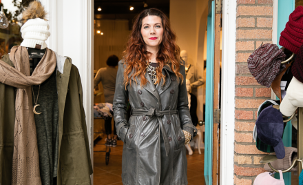 Image for: Mellicia Marx, entrepreneur and operator of Poplin Style Direction, poses in front of a boutique.