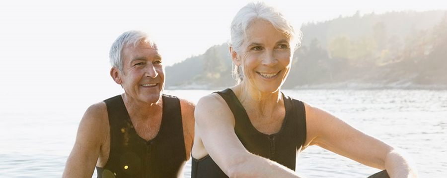 Image shows a healthy couple rowing on a lake to indicate the work of Edwards Lifesciences.
