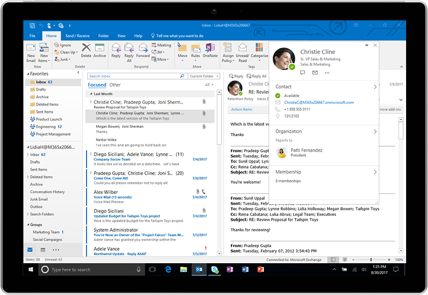 Image of the new people card displayed in Outlook for Windows. Shows contact information, organization and memberships for the selected person.