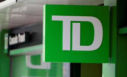 TD Bank Group sign hangs above a window.