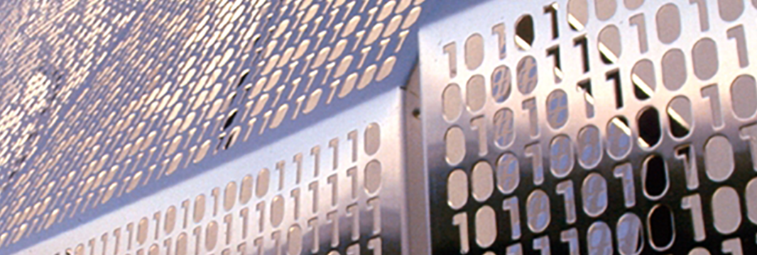 Image of zeroes and ones carved into metal plates.