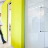 A worker walks into a meeting room at Accenture.