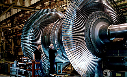 Image for: Image of two workes at GE.