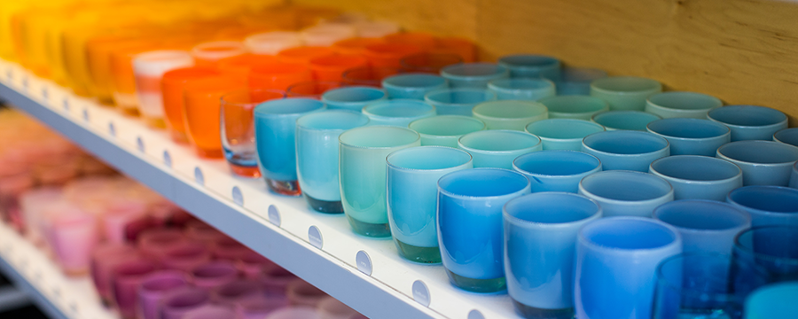 Image of a lineup of glassybaby votives.