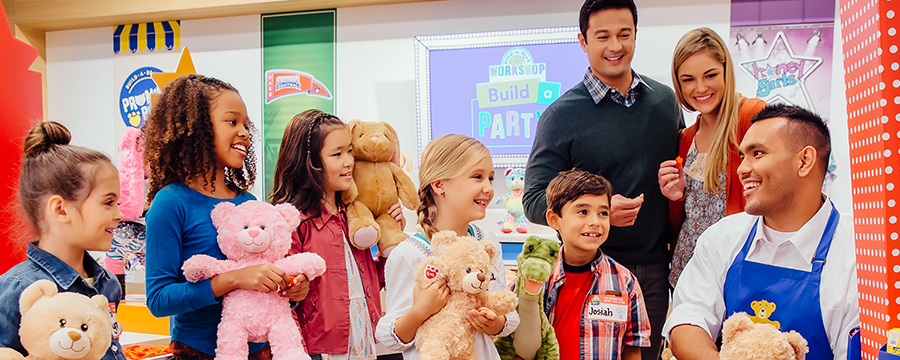 Image of kids and kids at heart enjoying a Build-A-Bear Workshop.