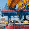 An image of cranes in a shipyard.