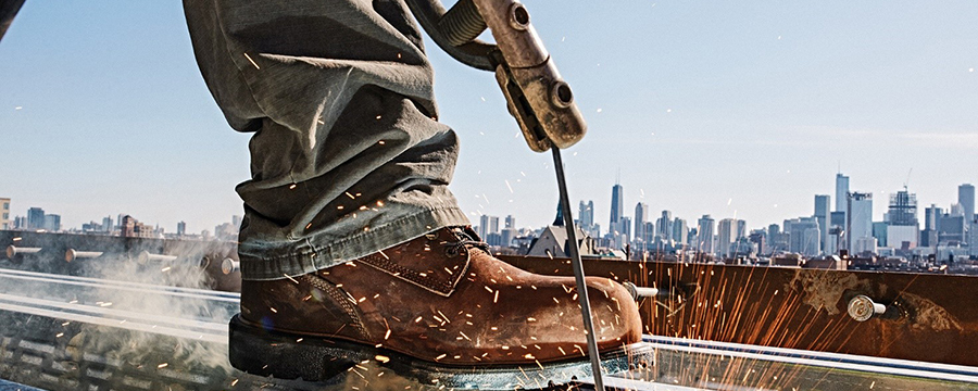 Image of a Red Wing shoe near welding sparks.