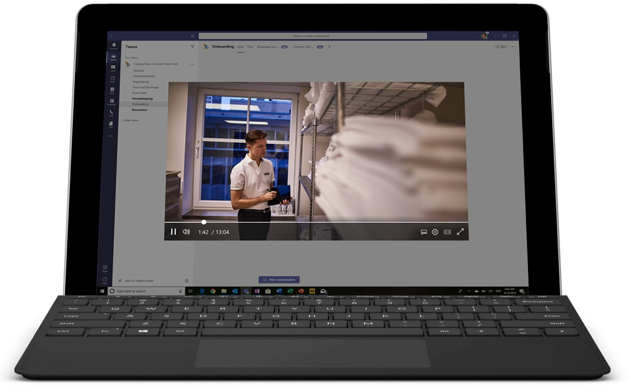 Image of a laptop open displaying a video in Microsoft Teams.