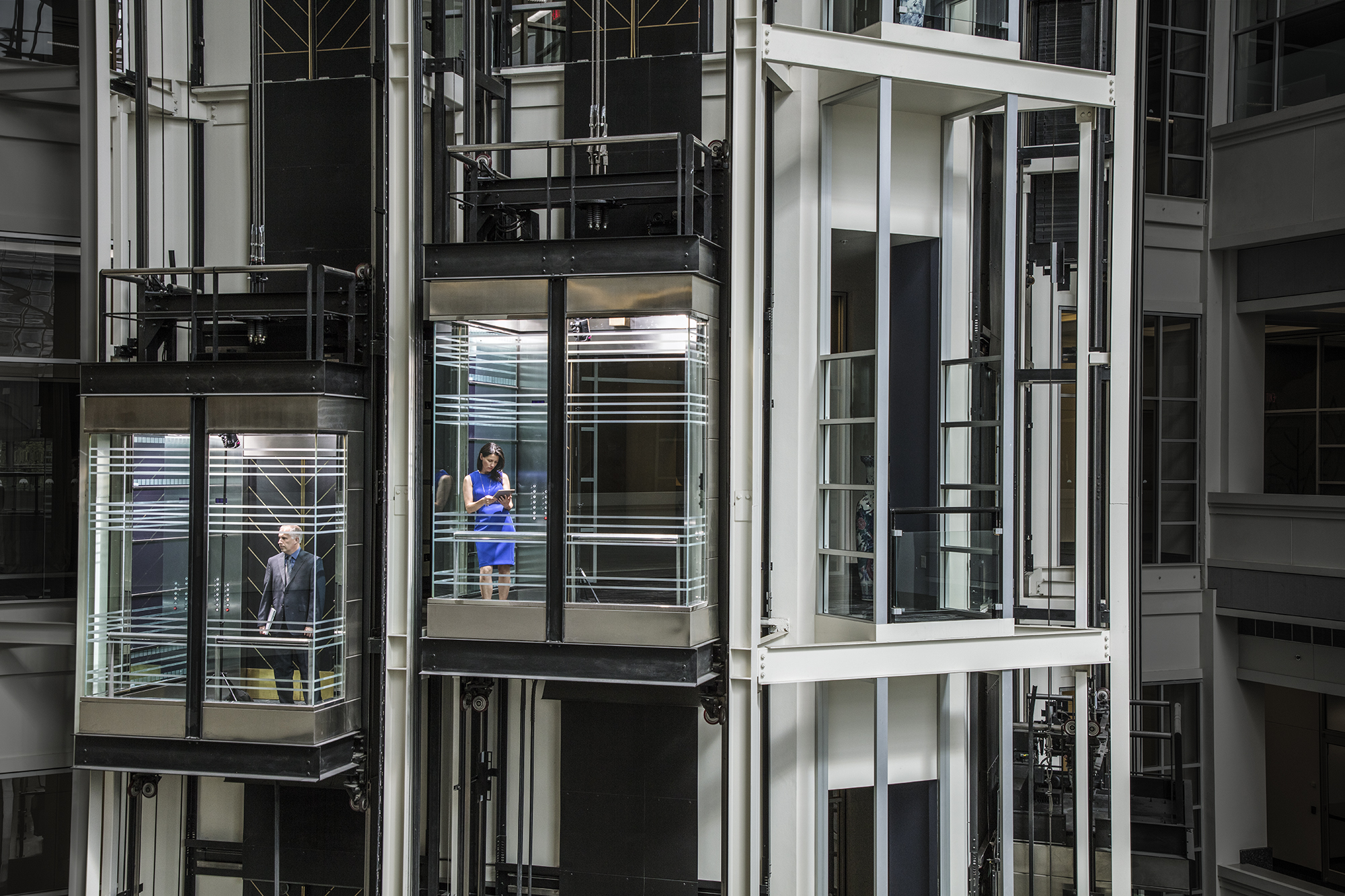 Image of two elevators passing.