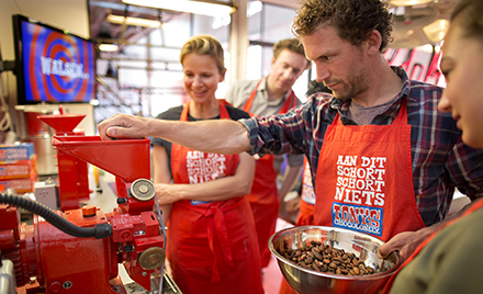Image of a worker scooping chocolate at Tony's Chocolonely.
